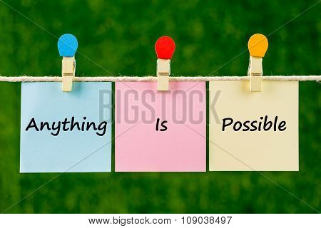 Word Quotes Of Anything Is Possible On Sticky Color Papers Hanging On Rope.