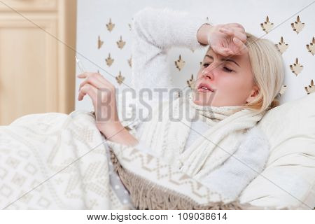 Sick young lady is suffering from influenza