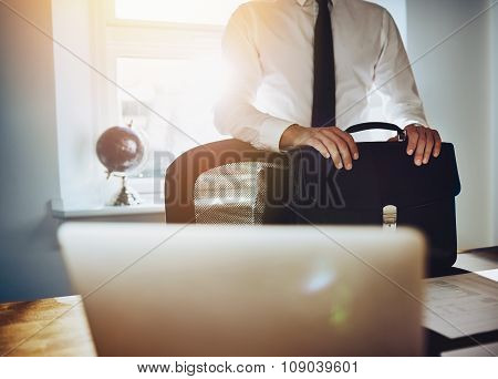 Business Concept, Man Standing At Desk With Briefcase