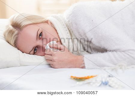 Ill blond woman is suffering from influenza