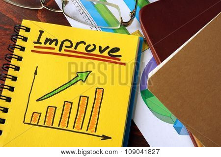 Notebook with improve sign. Business concept.