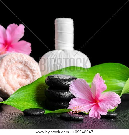 Beautiful Spa Background Of Pink Hibiscus Flowers, Leaf, Towel, Thai Herbal Compress Ball  And Stone