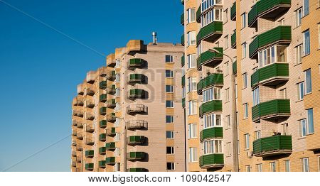 Apartment House On Blue Sky Background