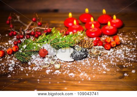 Concept Of Chinese New Year With Yin-yang Symbol, Apple, Cones, Red Ball, Fir Tree, Eight Candles An