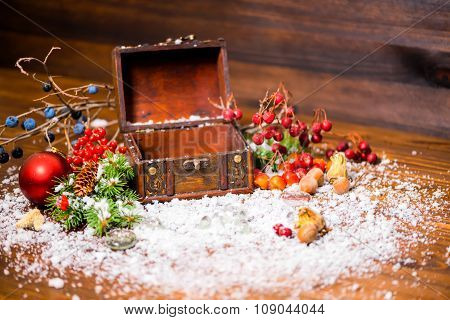 Christmas Winter Still Life With Opened Empty Chest, Apple, Nuts, Cones, Berries, Fir Tree And Snow,