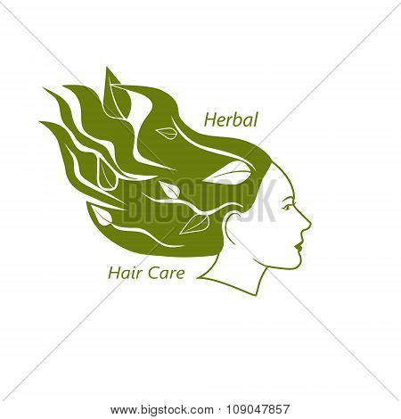 Woman head with wavy hair and leaves in it