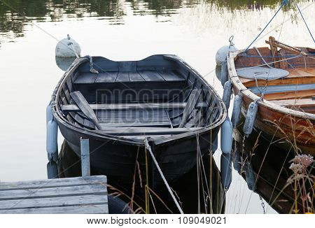 Two Rowboat In Calm Water In The Harbor
