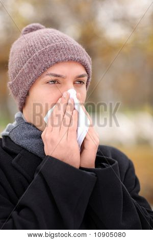 Infected Man Blowing His Nose In Tissue Paper