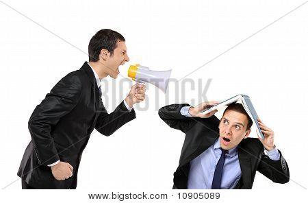 Angry Businessman Yelling To A Man Who Is Covering His Head