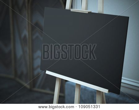 Wooden easel with a blank black canvas on the street.