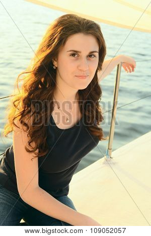 Portrait Of Attractive Young Girl Resting On The Yacht