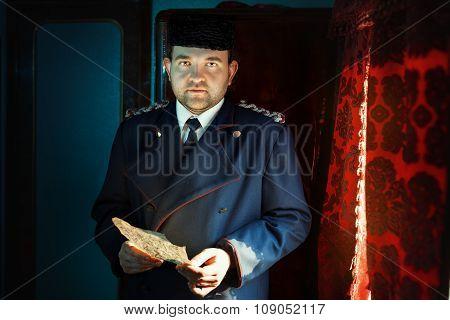 Sad Man Holding A Letter.