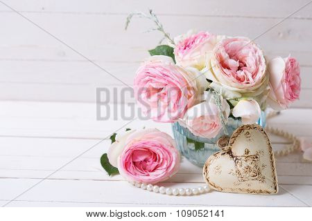 Background With Sweet Pink Roses Flowers  In Blue Vase And Decorative Heart