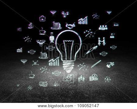 Finance concept: Light Bulb in grunge dark room