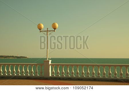 Seafront Embankment With White Balustrade And Lantern
