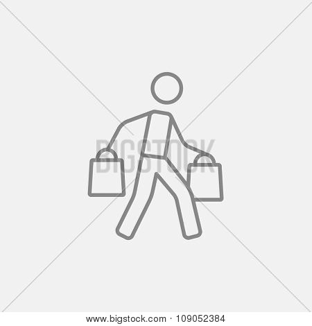 Man carrying shopping bags line icon for web, mobile and infographics. Vector dark grey icon isolated on light grey background.