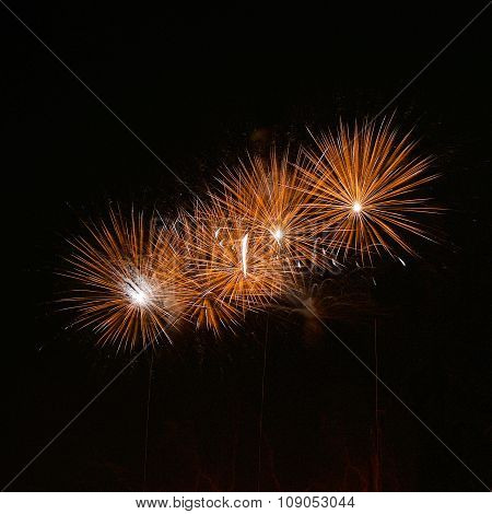 Golden orange amazing fireworks isolated in dark background close up with the place for text, Malta