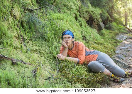 Hiker Woman Relaxing, Lying On The Green Moss