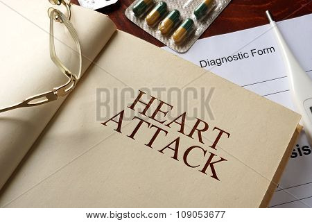 Book with diagnosis heart attack. Medic concept.