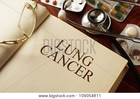 Book with diagnosis lung cancer. Medic concept.