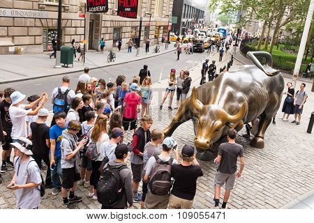 NEW YORK, UNITED STATES - JUNE 20, 2015: Charging Bull is a bronze sculpture by Arturo Di Modica that stands in Bowling Green Park in the Financial District in Manhattan, New York City.