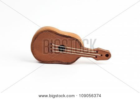 Toy Souvenir In The Form Of A Small Leather Guitar