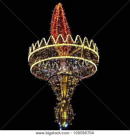 Construction In Form Of Torch In Christmas Bulbs