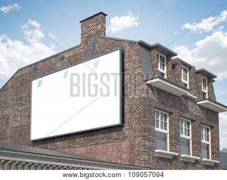 Blank billboard hanging on the classic building