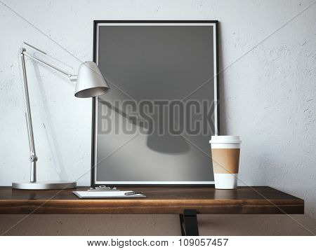 Black blank frame on the table with lamp
