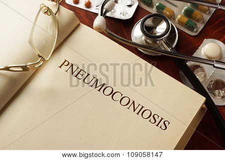 Book with diagnosis Pneumoconiosis. Medic concept.