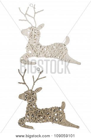 Christmas rattan reindeers isolated on the white background.