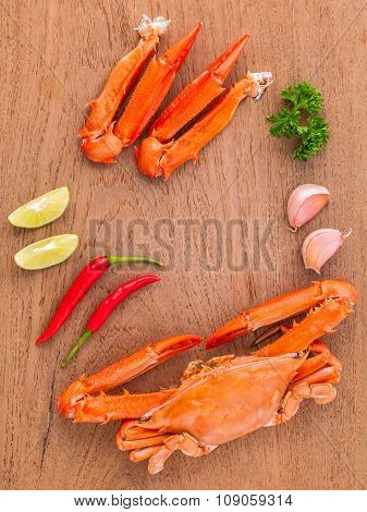Boiled Crab Claws With Lime,chilli ,garlic And Parsley On Wooden Background.