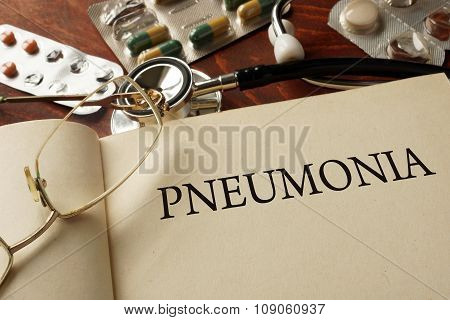 Book with diagnosis Pneumonia. Medic concept.