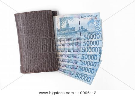 wallet and money over white