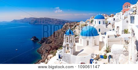 Panoramic Scenic View Of Beautiful White Houses On Santorini