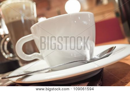 Cup Of Coffee Stands On A Table In Cafeteria