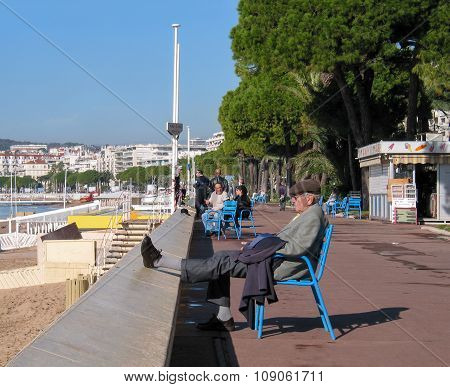 Cannes, France - November 3, 2003: People Taking A Rest At The Boulevard De La Croisette On November