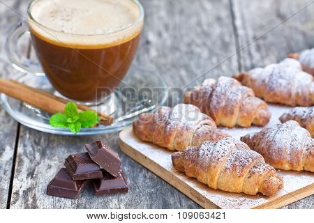 homemade fresh chocolate croissant with cup of cappuccino ** Note: Shallow depth of field