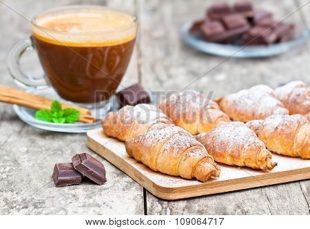 homemade fresh chocolate croissant with cup of cappuccino