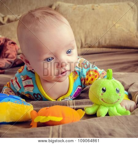 Baby Looking At Toys