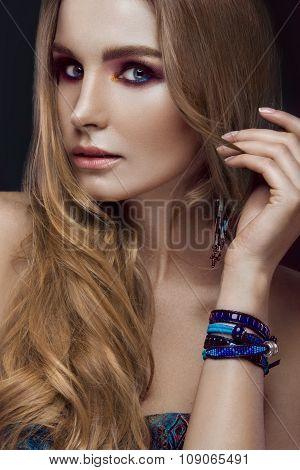 Beautiful fashion girl with bracelets boho style. Beauty face, bright trendy makeup.