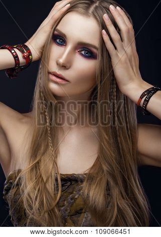 Beautiful fashion girl with bracelets boho style. Beauty face, bright trendy makeup.