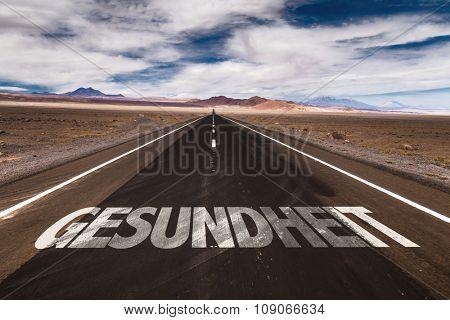 Health (in German) written on desert road
