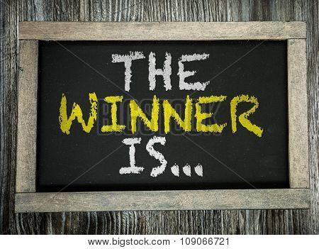 The Winner Is... written on chalkboard