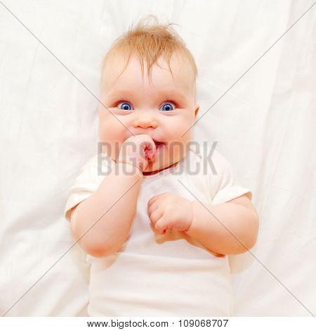 Happy Baby Sucking His Finger