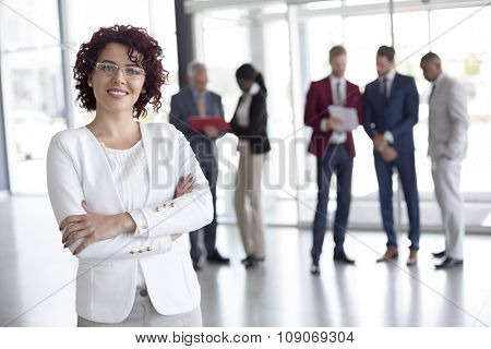 Portrait of cheerful businesswoman at work