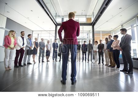 Business leader hold meeting with his team and tell them situation
