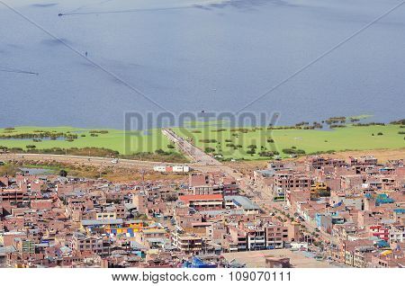 View Of The City By Titicaca Lake,