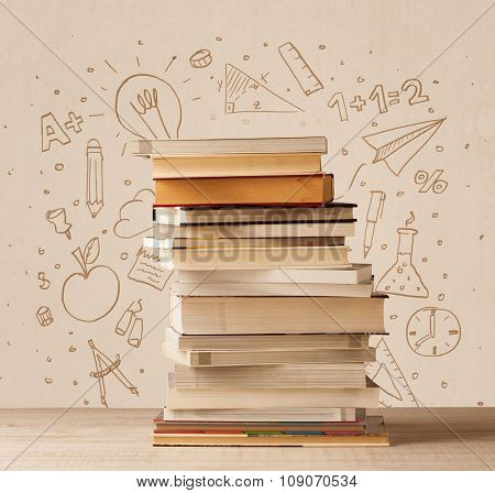 A pile of books on table with school hand drawn doodle sketches and symbols