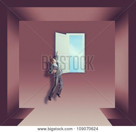 Businessman is hanging on the open door